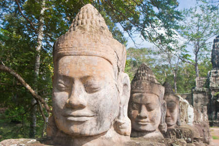 Sculpture in font of Angkor thom photo