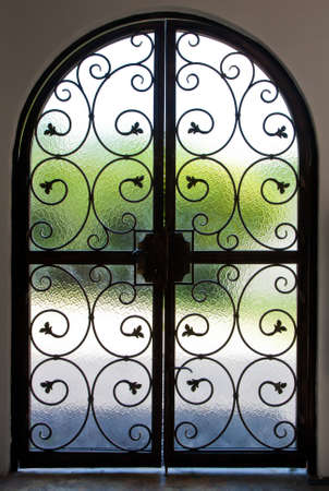 and gate: Wrought iron door Stock Photo