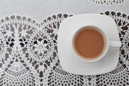 Coffee on the lace tablecloth photo