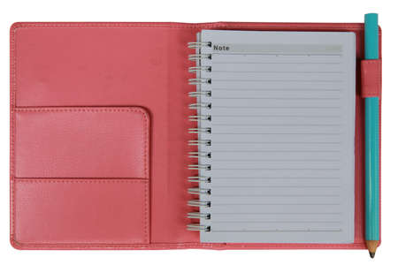 Pink notebook with blue pencil photo