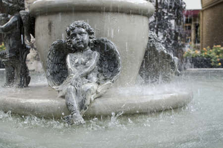 Cupid fountain statue photo