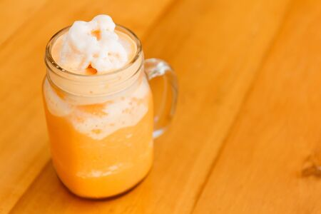 Thai milk tea smoothie in giant glass. Stok Fotoğraf