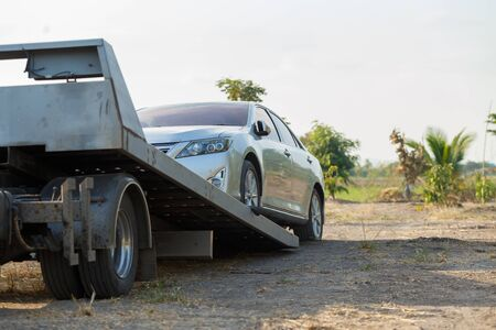 Tow car service on side for loading broken car to the garage. Stock Photo