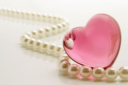 white pearls necklace and heart shape jewelry photo
