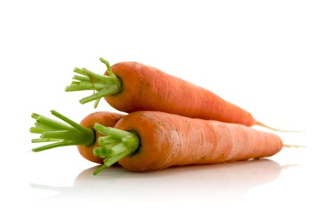 fresh carrots over white background photo