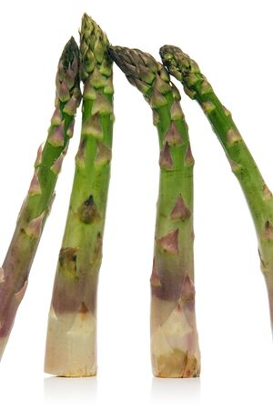 fresh asparagus isolated over white background photo