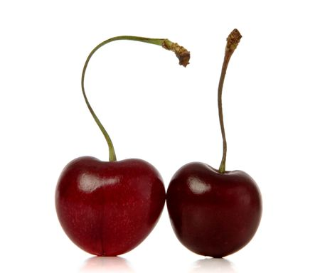 cherries isolated: cherries isolated over white background