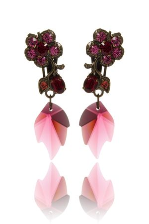 colorful pair of earrings over white background
