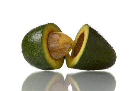 sliced avocado isolated over white background  photo