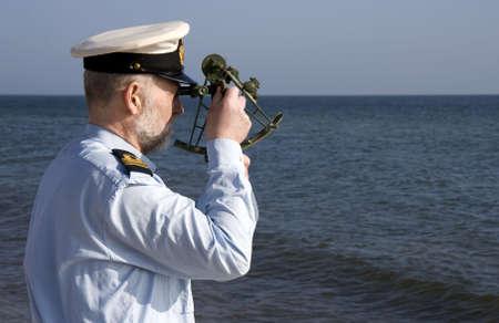 Navigator measuring the suns altitude on sea
