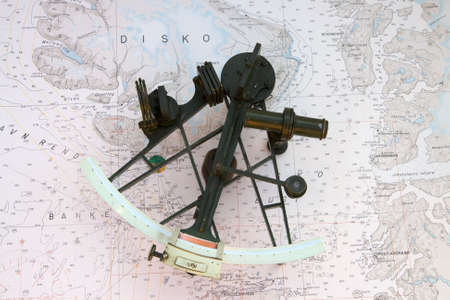 Old Sextant on a chart from the northern part of Greenland Stock Photo