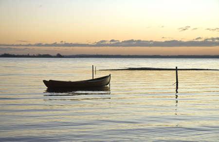 Dinghy in the sunset at Sondrup beach near Horsens, Denmark