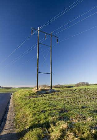 Power pylon in the field near Horsens, Denmark Stock Photo