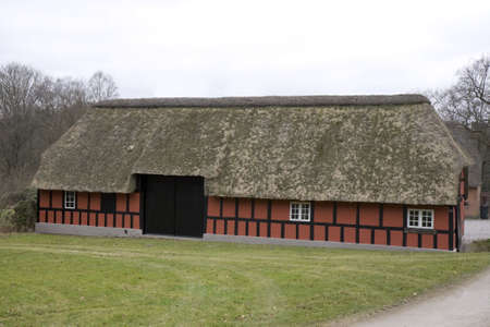 Small half-timbered farmhouse with thatched roof Stock Photo