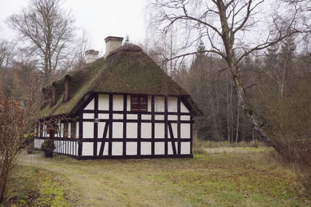 thatched roof: Small half-timbered house with thatched roof in a forest near Silkeborg, Denmark