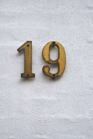 Number 19 on a white plastered wall