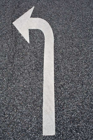 bended: White bended arrow on asphalt. Copy Space Stock Photo