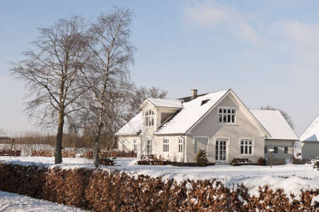 Small farmhouse in the snow. Copy space photo