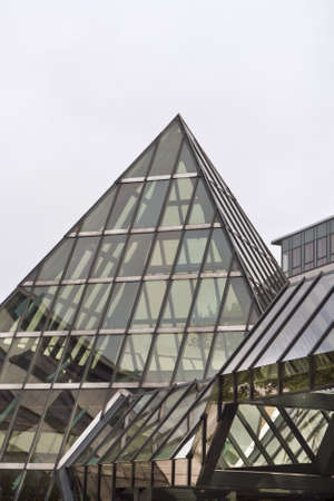 Architecture with a glass pyramid. Shot from Berlin, Germany. Copy space