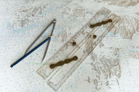 Parallel ruler, pencil and a pair of dividers on a Greenlandic chart