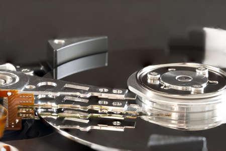 Close up on hard disk actuator arm photo