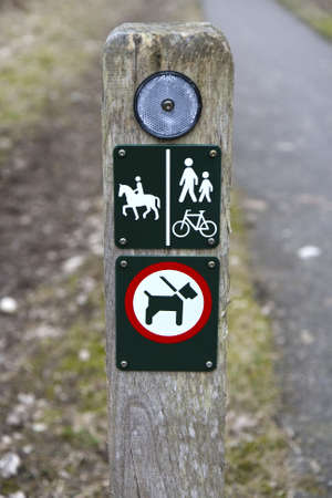 Signs on a pole at a Danish hiking path