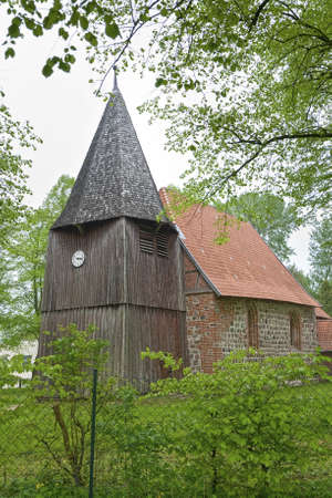 ddr: Small church with tower made of wood. Shot from the former DDR, Germany