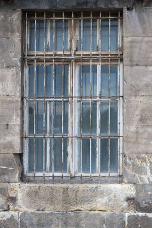 Close up on old barred window. Shot from Thale, Germany Stock Photo - 17087847