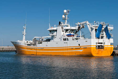 Yellow and White fishing vessel at port in Hirtshals, Denmark