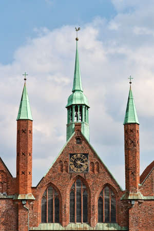 beck: Bell tower and two spires covered with copper plates. Shot from Lübeck, Germany