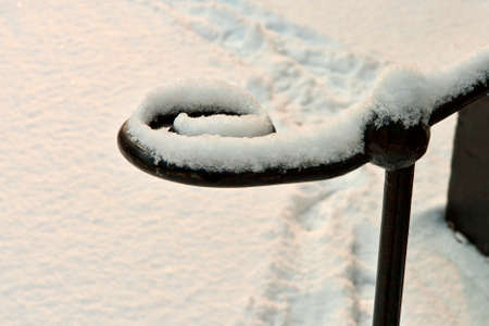 banisters: Closeup on snow on an iron banisters