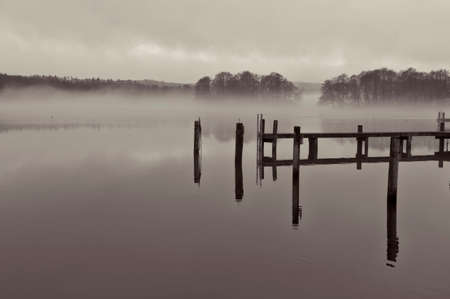 ry: Black and white shot of mist over a lake at Gammel Ry, Denmark Stock Photo