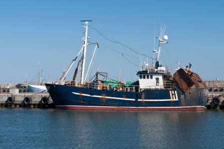 trawler: Stern trawler in port on a summer day