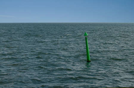 buoy: Closeup on a green buoy on a clear day Stock Photo
