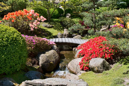 Small stream with a bridge in a Japanese Garden Stock Photo