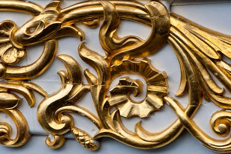 Closeup on part of a golden ornament on a tall ship