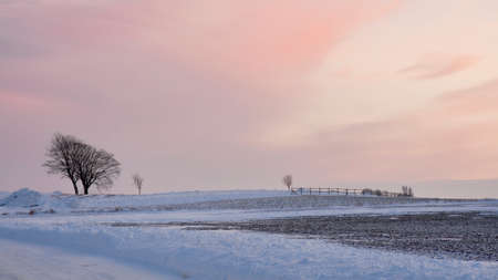 Sunset over the fields at winter time Stock Photo