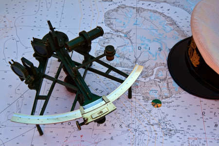 Old sextant on a nautical chart from the northern part of Greenland 스톡 콘텐츠