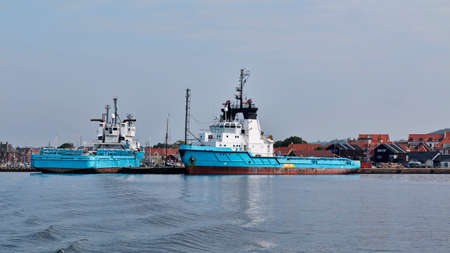 Blue offshore vessels in port