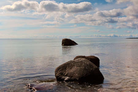 Closeup on rocks at the coast in calm weather