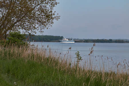 Small ferry passing an island