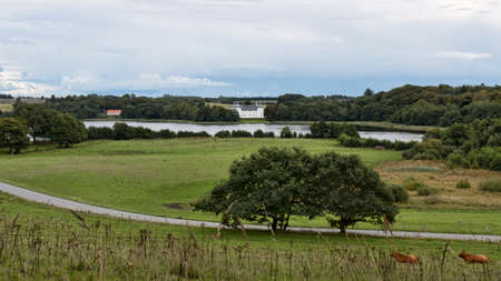 White castle at a lake in Jutland, Denmark Editorial