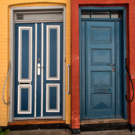 Closeup on old doors in red and yellow houses