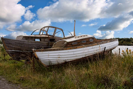 Closeup on old motorboats on the seashore