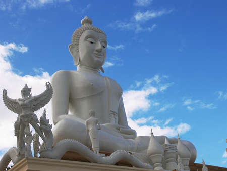Huge white Buddha image and blue sky  photo