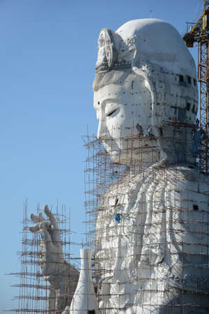 Guanyin Buddha which is currently under construction in Thailand. Requires a large number of artisans in construction. photo