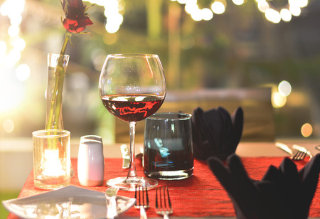 Set the table for dinner with wine romantic style Stock Photo