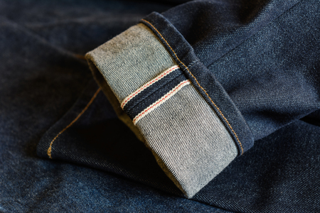 fold hem of red selvedge japan dark blue jeans vintage style denim, close up Reklamní fotografie