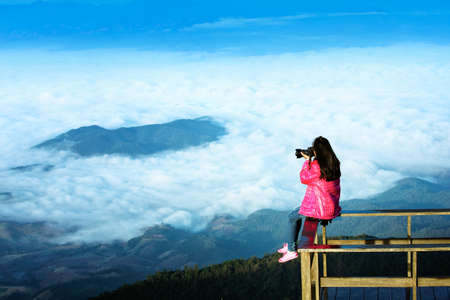 oneself: Traveller woman shoot over the cloud on terrace hill