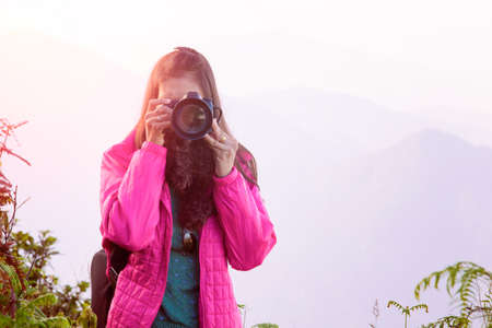 oneself: asian traveller shoot landscape on hill background